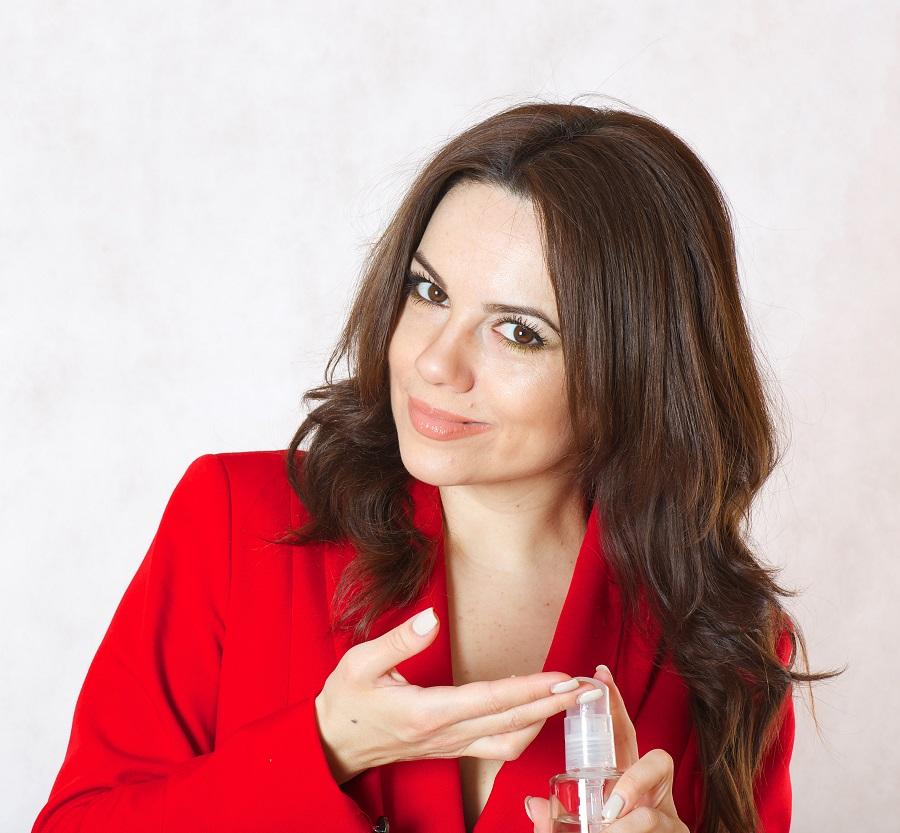 woman holding serum bottle