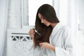 Woman using hair serum