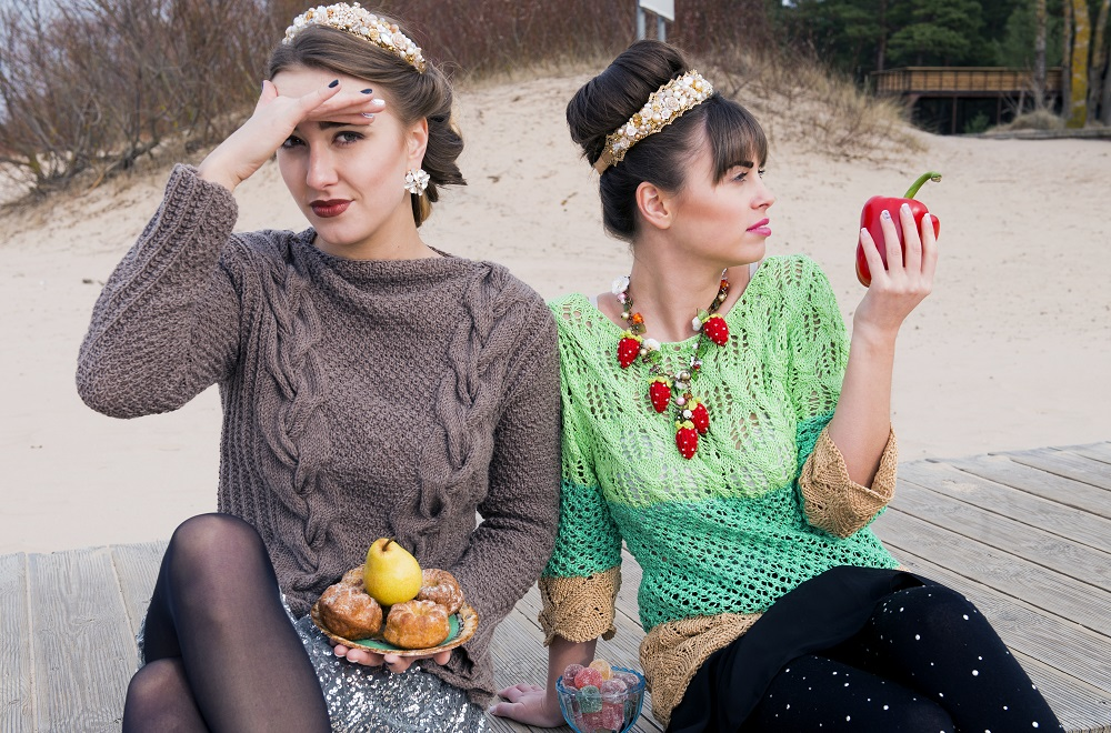 Young women holding fruits