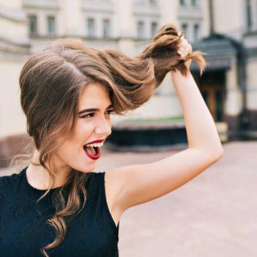 Woman holding hair