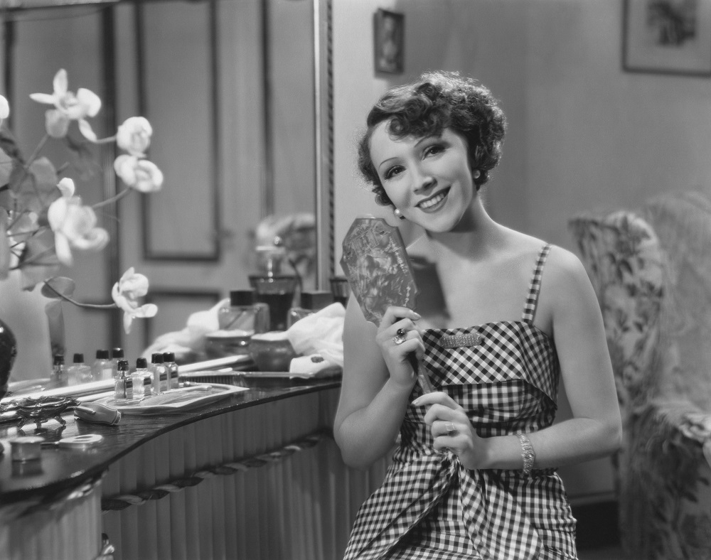 Vintage image of 1920s woman holding mirror