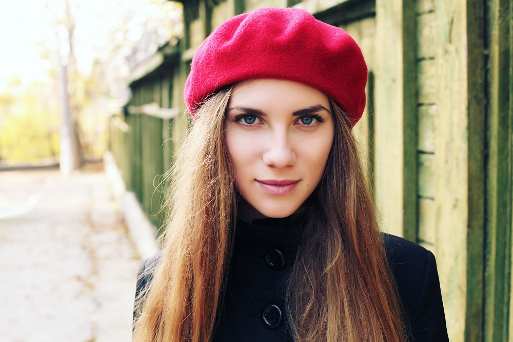 brunette woman wearing red beret