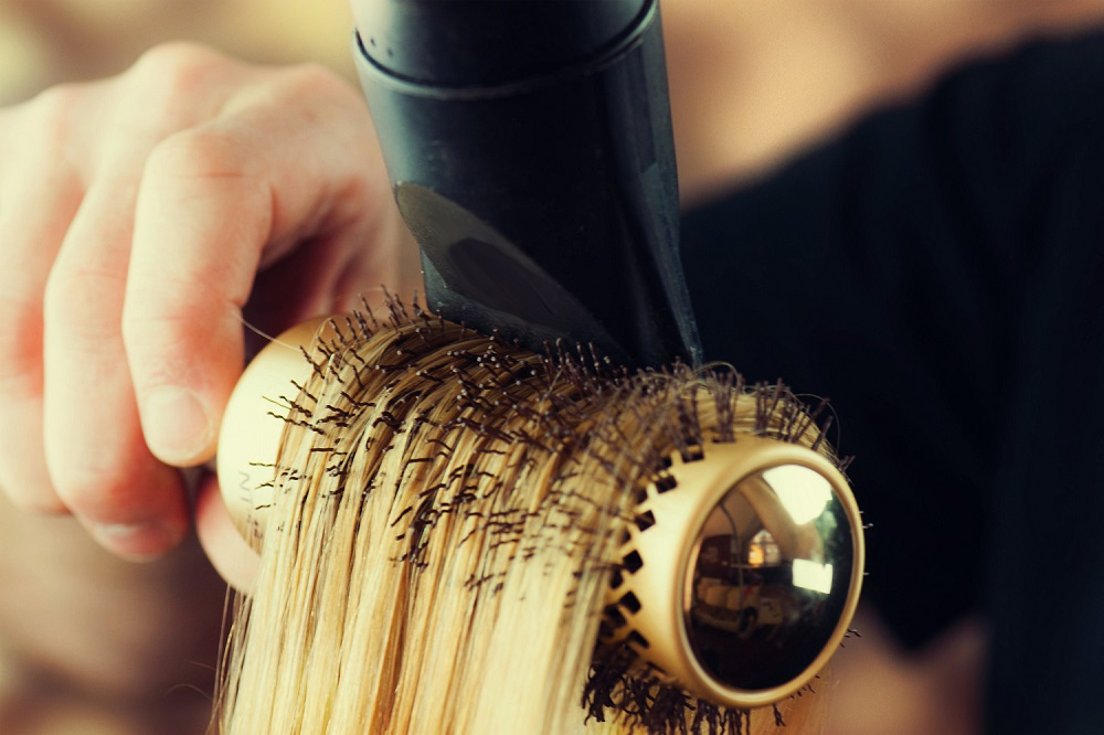 round brush and blow dryer close up