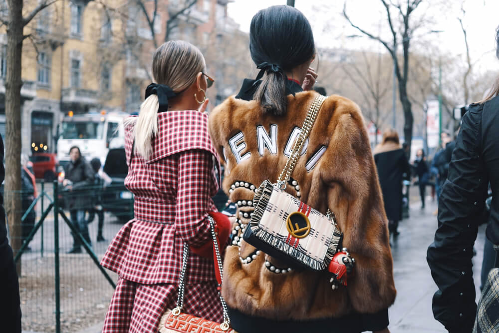 Two fashionable women after the Fendi fashion show at Milan Fashion Week Feb 2018