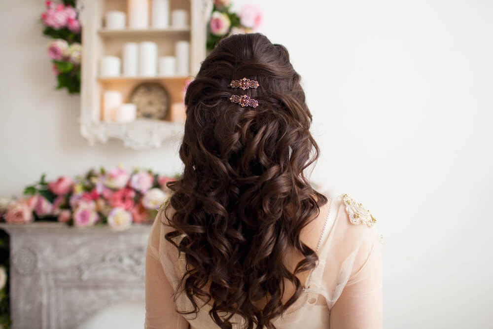 Woman with curly hair, half updo