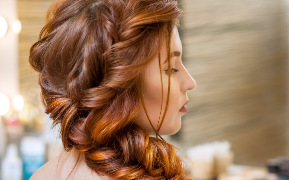 Wispy romantic wavy braid from the side