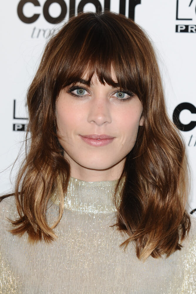 Alexa Chung with shaggy mid length and messy bangs