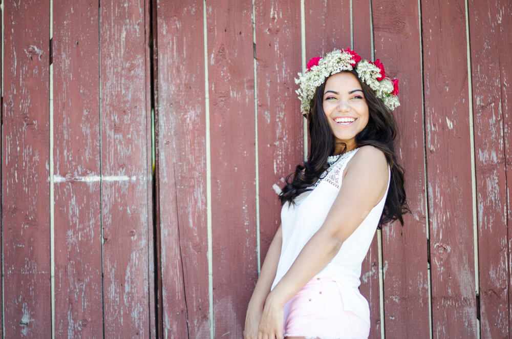 Pretty young smiling woman with flower crown