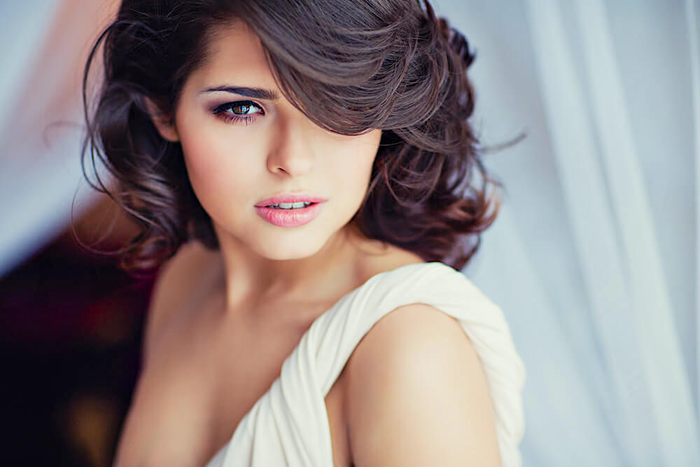 Beautiful woman with short hair bangs and waves