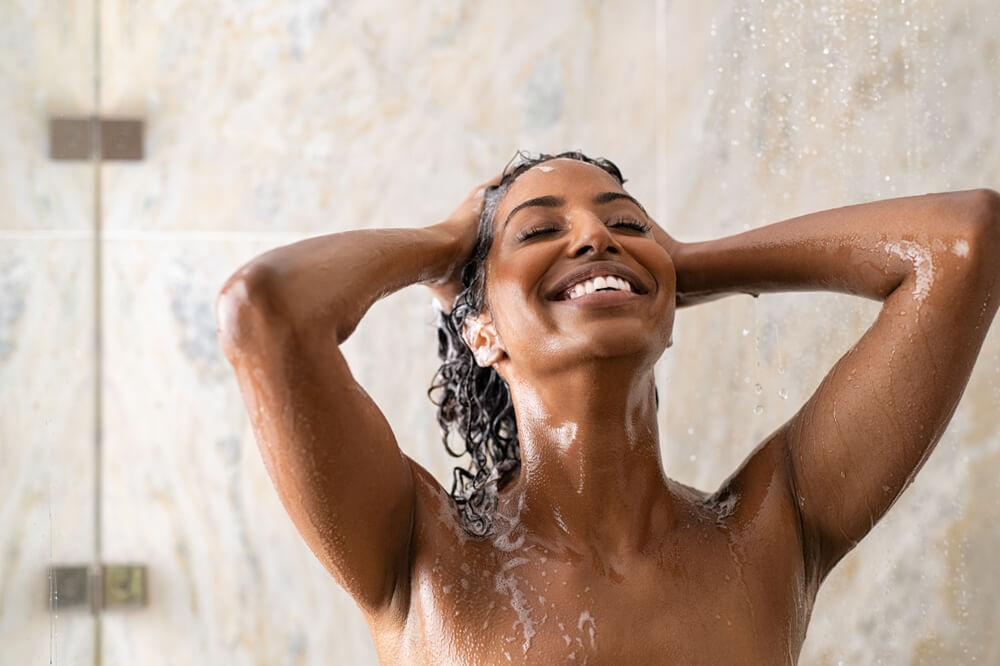 Woman washing hair in shower