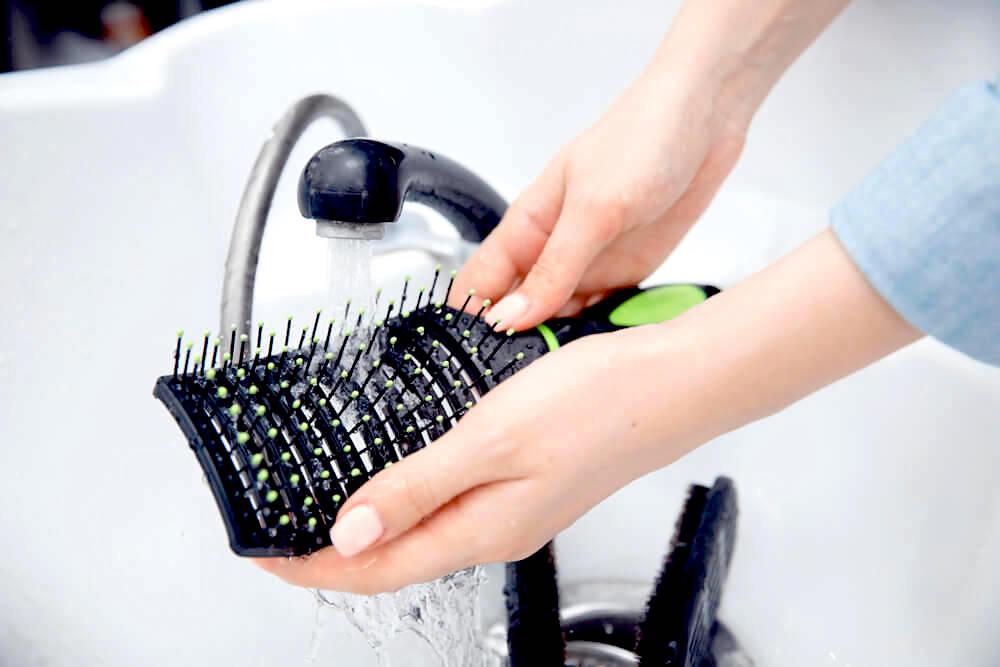 Rinsing hairbrush in the sink
