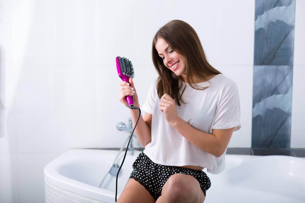 Woman using straightening brush
