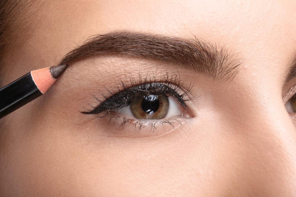 Woman using brow brush