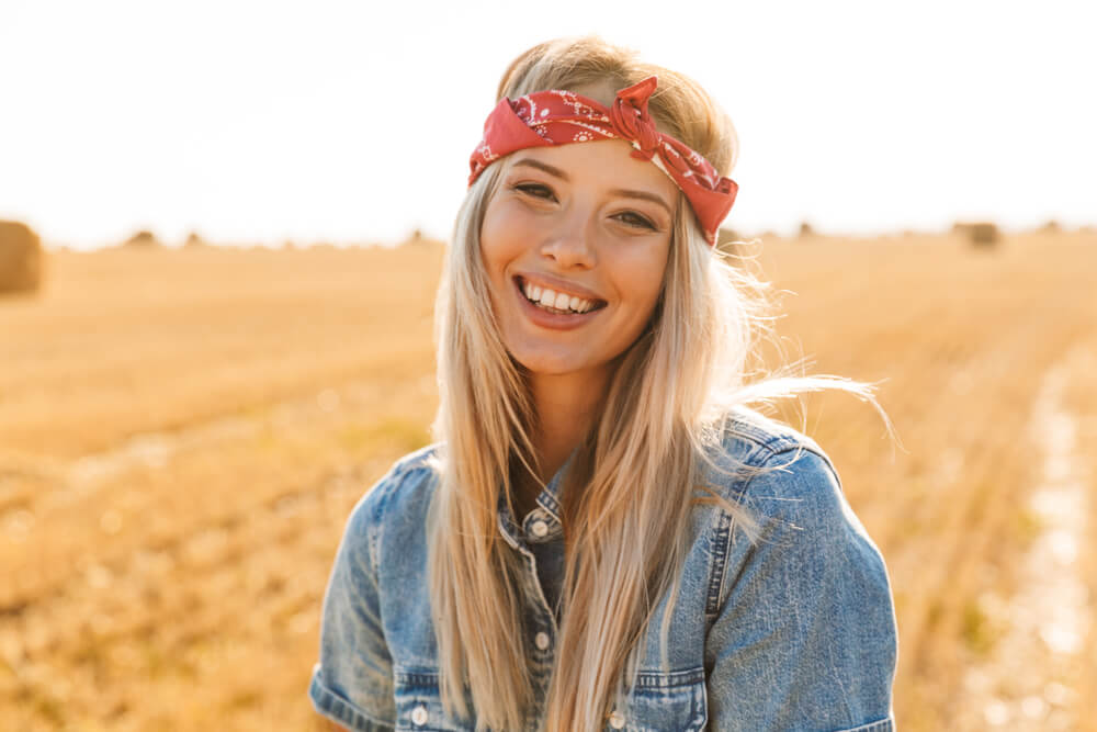 Happy smiling woman with red headband, summer
