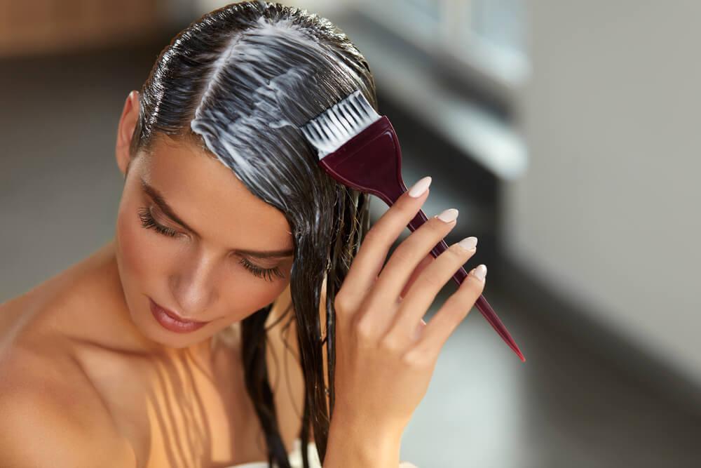 Woman applying hair mask
