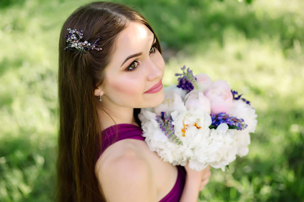 Young bridesmaid with straight hair and flowers