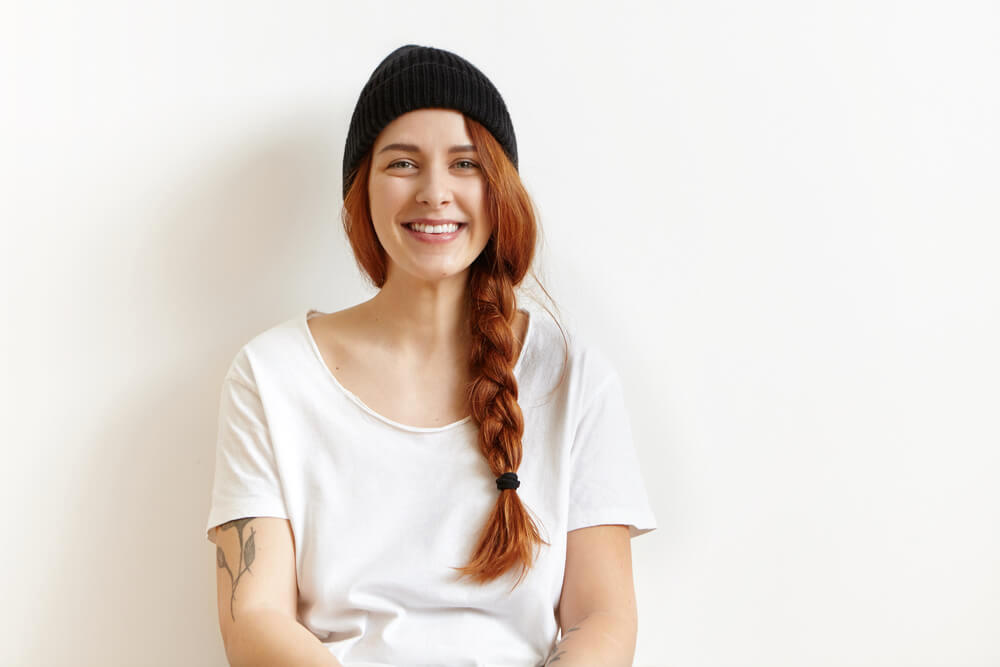 Young smiling woman with red hair and side braid