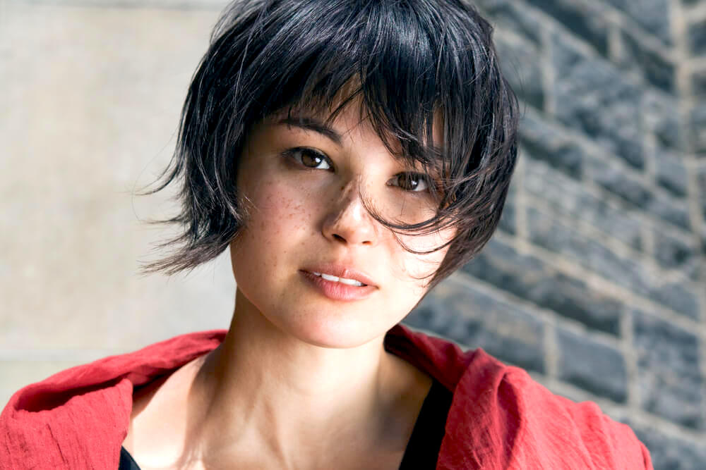 Young woman with pixie haircut outdoors