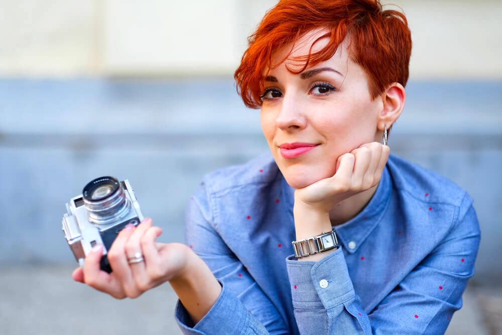 Woman with red hair and camera