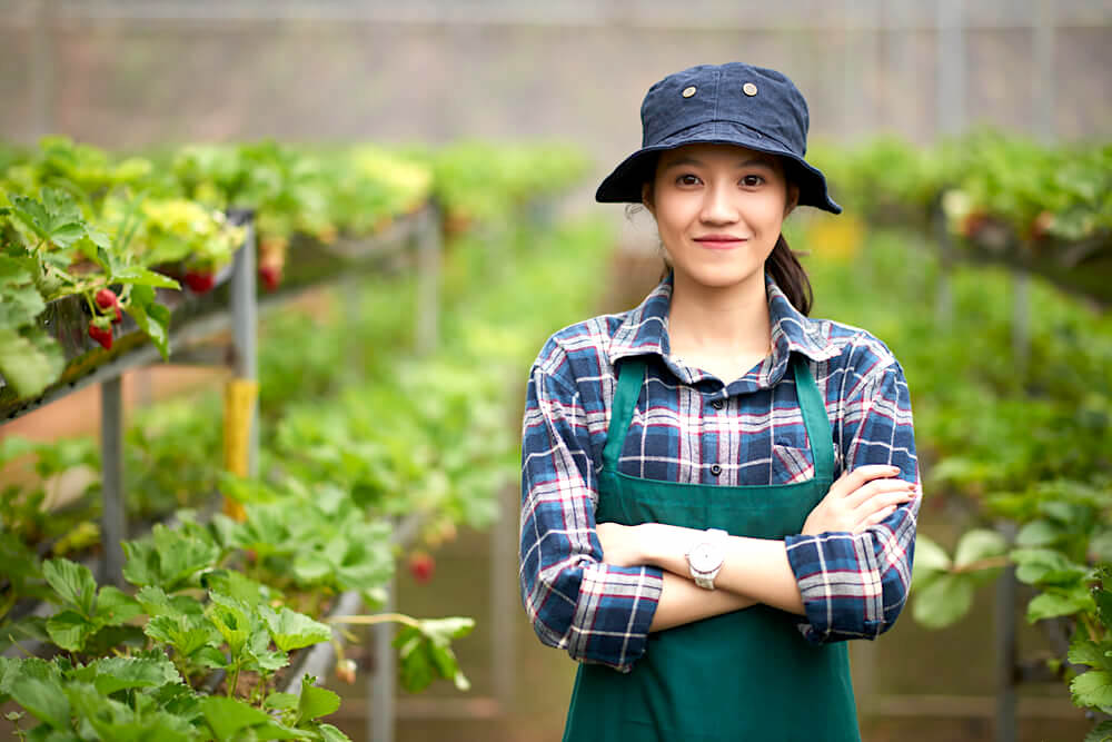 Young woman with bucket hat in a garden