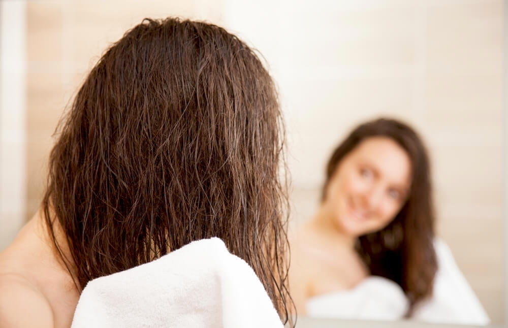 Close up of woman towel drying hair